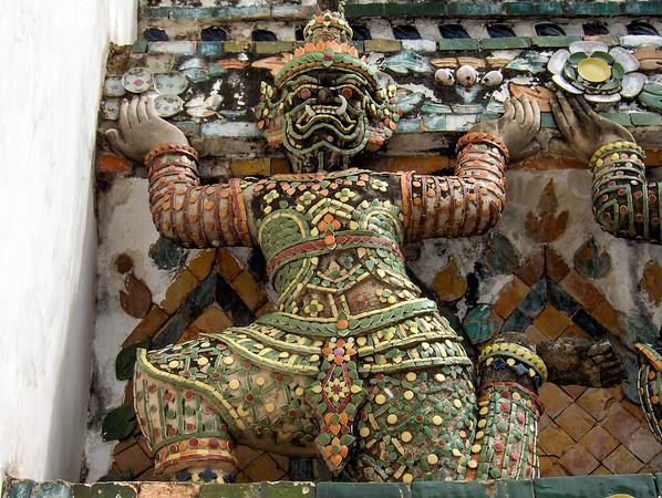 Sculpture details on Wat Arun's temple in Bangkok, Thailand