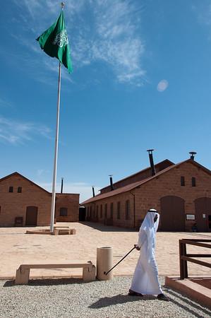 Saudian walking away with Saudian Flag, Saudi Arabia