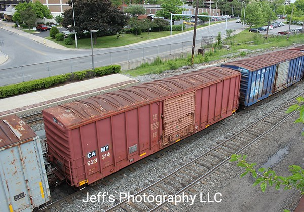 """Camp Chase Railway 50'7"""" 5000 cu. ft. Single Door Boxcar No. 523214 is westbound on Norfolk Southern local, C91, on the Pittsburgh Line in Altoona, Pennsylvania on 26 May 2016."""
