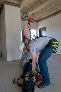 In this image released by the Texas Military Forces, Utah National Guardsmen and local Emergency Medical Technicians conduct repel training together in Dallas, Texas, Saturday, Jan. 30, 2011. This interagency collaboration supports the security efforts of Super Bowl 45. The Texas National Guard regularly focuses on the safety of its citizens and welcomed the added support of another state's military assets. (Photo/100th Mobile Public Affairs Detachment, Army National Guard Sgt. Josiah Pugh)