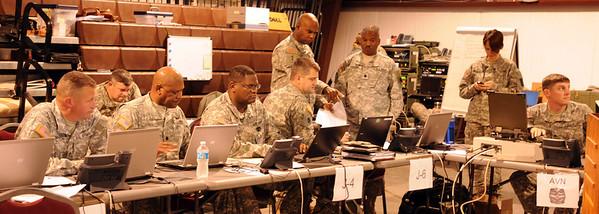 In this image released by the Texas Military Forces, service members with the Oklahoma Air and Army National Guards man the Tactical Operations Center at Camp Gruber for Operation Sooner Response on November 15, 2011. Texas Soldiers supported the mission by contributing the 6th Civil Support Team and personnel assets from the Homeland Response Force.