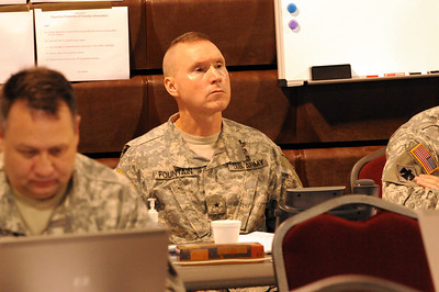 In this image released by the Texas Military Forces, Operation Sooner Response Director Brig. Gen. Walter Fountain receives update briefs from state representatives and staff sections at Camp Gruber, Oklahoma, November 15, 2011. The event featured six states engaging simulated disaster incidents throughout five sites in Oklahoma. Texas Soldiers supported the mission by contributing the 6th Civil Support Team and personnel assets from the FEMA Region VI Homeland Response Force.