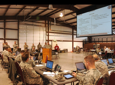 In this image released by the Texas Military Forces, state representatives and staff sections provide update briefs to the Operation Sooner Response director, Brig. Gen. Walter Fountain, November 15, 2011. The event featured six states engaging simulated disaster incidents throughout five sites in Oklahoma. Texas Soldiers supported the mission by contributing the 6th Civil Support Team and personnel assets from the FEMA Region VI Homeland Response Force.