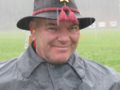 Joe Higgins, Winslow's Battery, Fall 2006. Smiling in the rain! Photo submitted by Matthew Mackintosh.