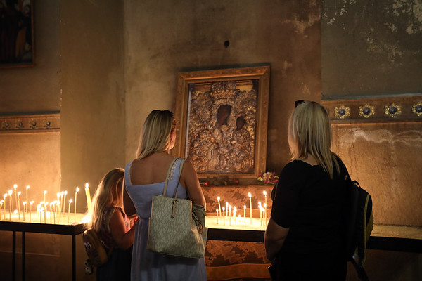 Worshippers pause for contemplation at an icon of the Madonna and Child, inside the Armenian Cathedral in central Lviv, Ukraine