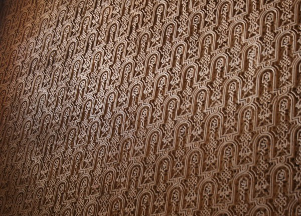 Detail of an ornately-decorated wall in the Alhambra in Granada, Spain