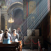 Light streams through the window onto worshippers during a service at the Armenian Cathedral in central Lviv, Ukraine