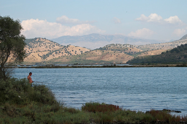A man fishes in Lake Butrint in southern Albania