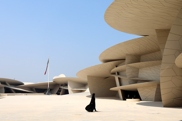 Doha / Qatar – September 30, 2019: A local woman walks through the main courtyard of the National Museum of Qatar