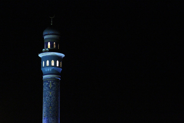 A minaret of the Al Saddiyah mosqe against the night sky in Mutrah, Oman