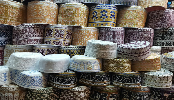 Caps on sale in Mutrah souq, Oman