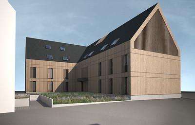 09 Sonne in Bleibach. Bestandsgebäude und Neubau bilden einen Innenhof.