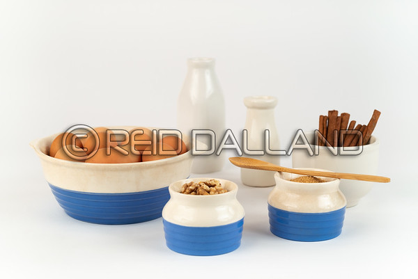 Farm Fresh Organic Free Range Eggs, Walnuts, Organic Sugar in Blue and White Bowls.