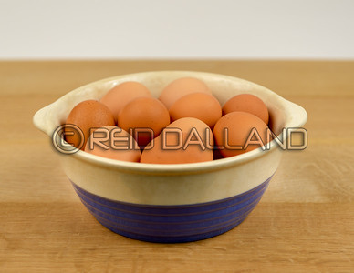 Farm Fresh Organic Free Range Eggs in Blue and White Bowl on Farm Table. Farm to Table