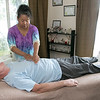 Reiki Master Carolyn Sargent in her home reiki office working on client Jeff Bingham. She will be doing a demonstration at the Lunenburg Public Library next week. SENTINEL & ENTERPRISE/JOHN LOVE