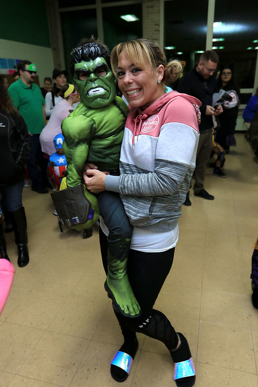 . Reingold Elementary held a Halloween dance on Friday night, October 26, 2018. Enjpying the dance is Cole Colon dressed as the Hulk with his mom Ashley Howe. SENTINEL & ENTERPRISE/JOHN LOVE