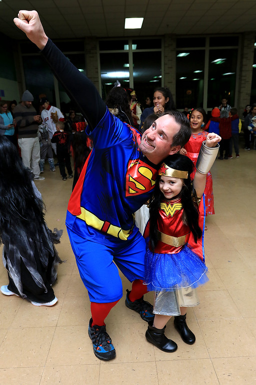 . Reingold Elementary held a Halloween dance on Friday night, October 26, 2018. This super hero duo is Dan with his daughter Rachel Bingham, 6. SENTINEL & ENTERPRISE/JOHN LOVE