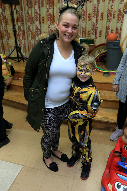. Reingold Elementary held a Halloween dance on Friday night, October 26, 2018. Ellie Green poses with her son Cameron Stone, 7, dressed up as Bubble Bee from the Transformers movies. SENTINEL & ENTERPRISE/JOHN LOVE