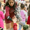 Reingold Elementary School held a Red and Gray rally at the school on Tuesday, Nov. 26, 2019 to get fired up for the up coming 125th Thanksgiving Day football game against Fitchurg and Leominster. Visiting the school to help with the rally where members of the High School football team, cheerleaders and the band. High fiving students just before the rally started is senior cheerleader Dahiana Rodriguez. SENTINEL & ENTERPRISE/JOHN LOVE