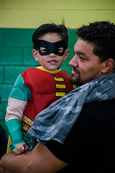 Ezequiel Troche, 4, hangs out with dad Sam during Reingold Elementary School's annual Halloween Dance on Friday evening. SENTINEL & ENTERPRISE / Ashley Green