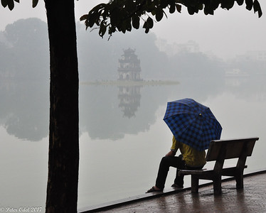 He just sat there a rainy morning in Hanoi..