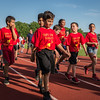 Students from South St Elementary parade down the back stretch of Crocker Field at the opening ceremonies of the Junior-Senior Relays. SENTINEL&ENTERPRISE/ Jim Marabello
