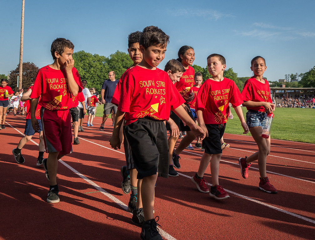 . Students from South St Elementary parade down the back stretch of Crocker Field at the opening ceremonies of the Junior-Senior Relays. SENTINEL&ENTERPRISE/ Jim Marabello