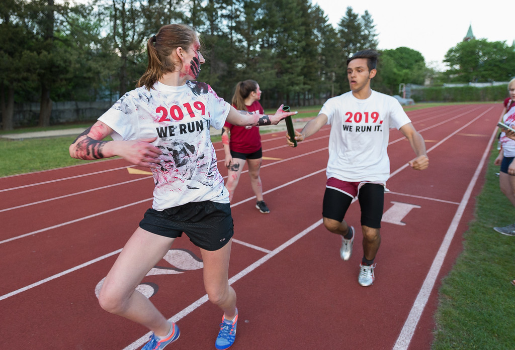 . Sophomores make the baton exchange during the Junior-Senior Relays at Crocker Field.  SENTINEL&ENTERPRISE/ Jim Marabello