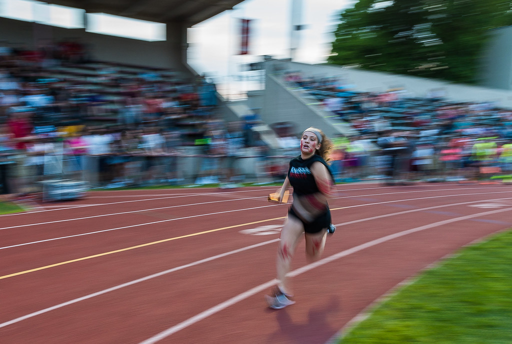. FHS Senior Alydia Le comes into the turn in front of packed grandstands during the Junior-Senior Relays at Crocker Field.  SENTINEL&ENTERPRISE/ Jim Marabello