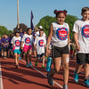 Students from Crocker Elementary march down the back stretch of Crocker Field during the opening ceremonies of the Junior-Senior Relays. SENTINEL&ENTERPRISE/ Jim Marabello