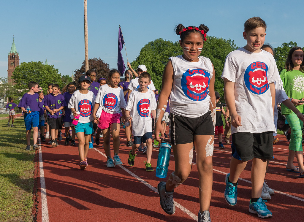 . Students from Crocker Elementary march down the back stretch of Crocker Field during the opening ceremonies of the Junior-Senior Relays. SENTINEL&ENTERPRISE/ Jim Marabello