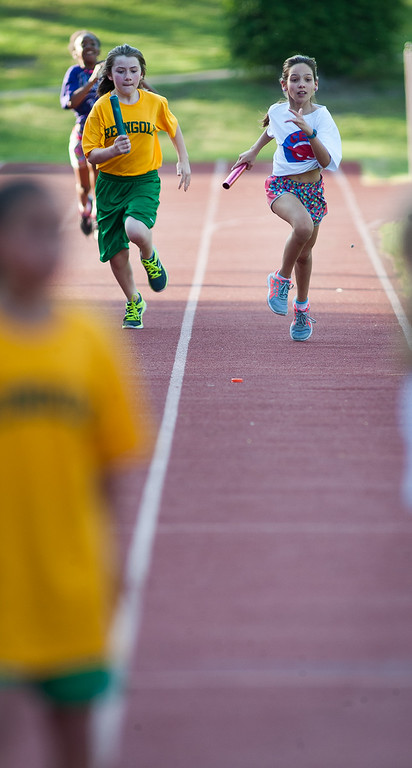 . Students from Crocker Elementary, Reingold, and McKay Arts Academy come down the front stretch at the beginning of the Junior-Senior Relays at Crocker Field. SENTINEL&ENTERPRISE/ Jim Marabello