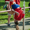 A student from South St Elementary flips for the Junior-Senior Relays at Crocker Field. SENTINEL&ENTERPRISE/ Jim Marabello