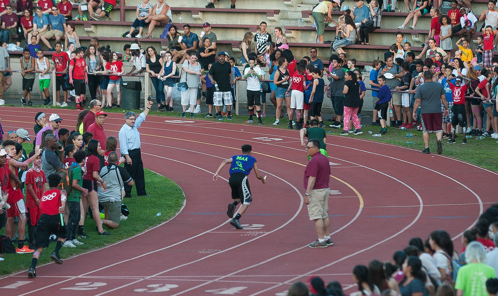 . Fitchbug Mayor Steve DiNatale fires the starting gun to begin the MIddle School race during the Junior-Senior Relays at Crocker Field.  SENTINEL&ENTERPRISE/ Jim Marabello