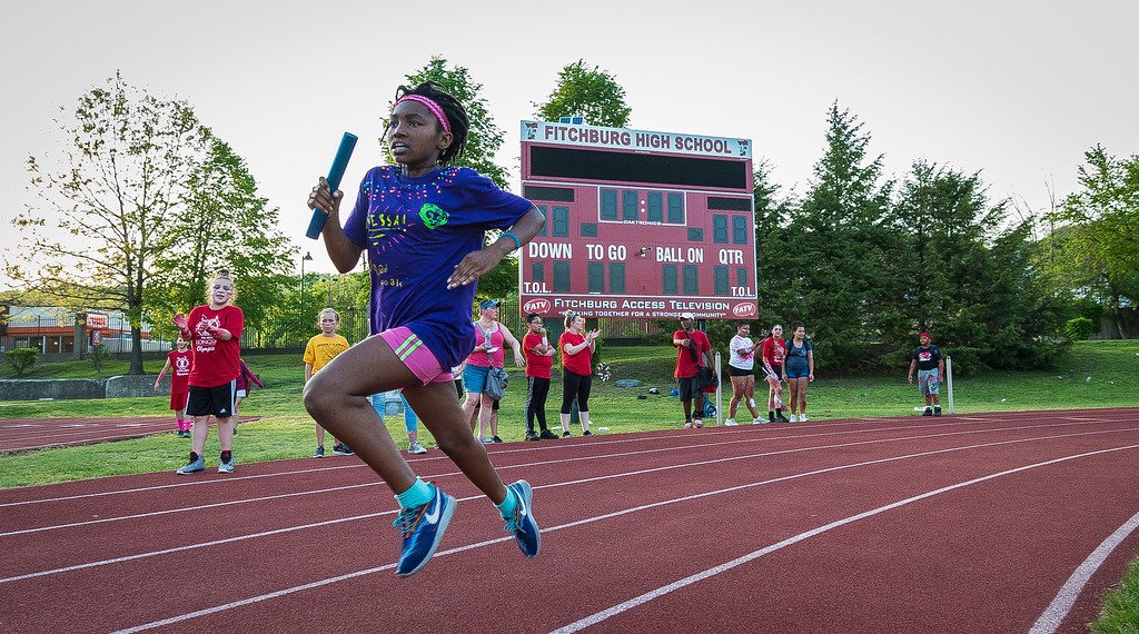 . A McKay Arts student rounds the corner during the Junior-Senior Relays at Crocker Field.  SENTINEL&ENTERPRISE/ Jim Marabello