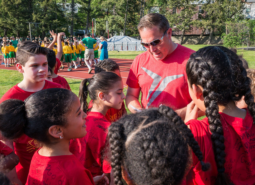 . South St Elementary Phys Ed teacher Corey Beaulac prepares his troops prior to  the Junior-Senior Relays at Crocker Field. SENTINEL&ENTERPRISE/ Jim Marabello