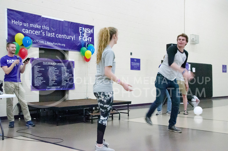 Nate Kochuyt, sophomore in theatre and member of On the Spot Improv, plays a game with volunteer Tori Falwell, senior in biology, at Relay for Life on Saturday, March 2, 2018, at Chester E. Peters Recreation Complex. (Tiffany Roney | Collegian Media Group)