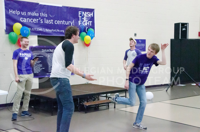 Nate Kochuyt (left), sophomore in theatre and member of On the Spot Improv, and Jacob Casey, sophomore in business administration and political science, play a game at Relay for Life on Saturday, March 2, 2018, at Chester E. Peters Recreation Complex. (Tiffany Roney | Collegian Media Group)