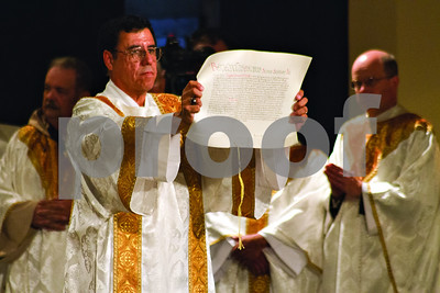 Photo by Shannon Wilson / Tyler Morning Telegraph    The Apostolic Letter is read and shown to everyone in attendence at the Episcopal Ordination of Bishop Joseph E. Strickland as the 4th Bishop of the Diocese of Tyler at the Caldwell Auditorium in Tyler.