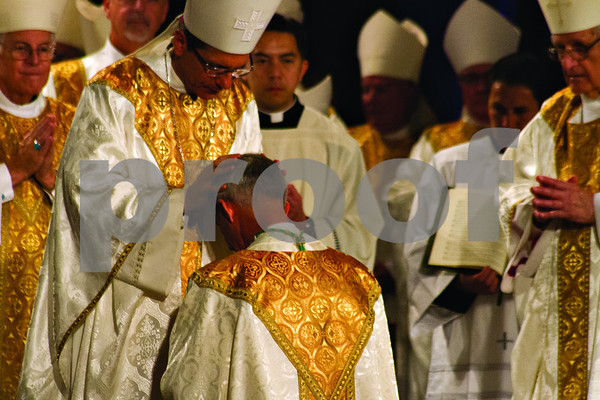 Photo by Shannon Wilson / Tyler Morning Telegraph     The Laying on of Hands is perfomed at the Episcopal Ordination of Bishop Joseph E. Strickland as the 4th Bishop of the Diocese of Tyler at Caldwell Auditorium in Tyler.