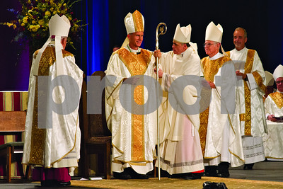Photo by Shannon Wilson / Tyler Morning Telegraph   Bishop Joseph E. Strickland is invested with the Pastoral Staff at his Episcopal Ordination as the 4th Bishop of the Diocese of Tyler at Caldwell Auditorium in Tyler.
