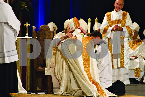 Photo by Shannon Wilson / Tyler Morning Telegraph       The miter is placed on the head of Bishop Joseph E. Strickland at his Episcopal Ordination as the 4th Bishop of the Diocese of Tyler at Caldwell Auditorium in Tyler.