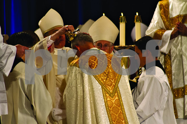 Photo by Shannon Wilson / Tyler Morning Telegraph  Bishop Joseph E. Strickland's head is anointed with oil at his Episcopal Ordination as the 4th Bishop of the Diocese of Tyler at Caldwell Auditorium in Tyler.