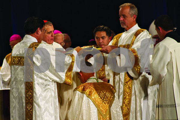 Photo by Shannon Wilson / Tyler Morning Telegraph      The Prayer of Consecration is performed while the Book of the Gospels is placed over the head of Bishop Joseph E. Strickland at his Episcopal Ordination as the 4th Bishop of the Diocese of Tyler at Caldwell Auditorium in Tyler.