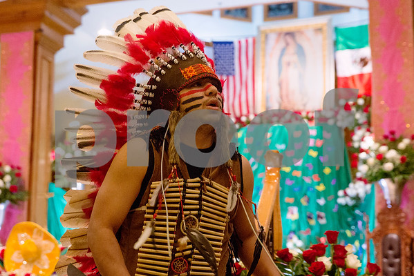 A dancer performs at Día de la Virgen de Guadalupe feast day and mass, celebrated at St. Peter Claver Parish in Tyler, Texas, on Tuesday, Dec. 12, 2017. Día de la Virgen de Guadalupe honors the belief that Jesus' mother Mary, Mexico's patron saint, appeared to Juan Diego in Mexico City in 1531. (Chelsea Purgahn/Tyler Morning Telegraph)