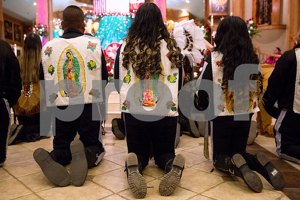 Dancers kneel at Día de la Virgen de Guadalupe feast day and mass, celebrated at St. Peter Claver Parish in Tyler, Texas, on Tuesday, Dec. 12, 2017. Día de la Virgen de Guadalupe honors the belief that Jesus' mother Mary, Mexico's patron saint, appeared to Juan Diego in Mexico City in 1531. (Chelsea Purgahn/Tyler Morning Telegraph)