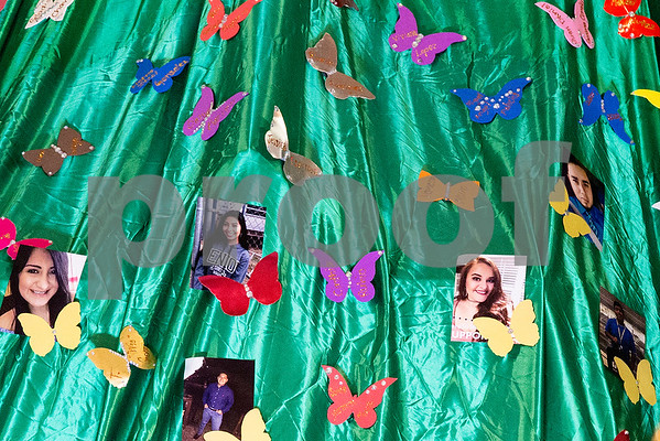 Pictures of DACA recipients and butterflies with the names of DACA recipients at the altar during Día de la Virgen de Guadalupe feast day and mass, celebrated at St. Peter Claver Parish in Tyler, Texas, on Tuesday, Dec. 12, 2017. Día de la Virgen de Guadalupe honors the belief that Jesus' mother Mary, Mexico's patron saint, appeared to Juan Diego in Mexico City in 1531. (Chelsea Purgahn/Tyler Morning Telegraph)