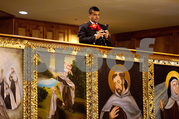 A mariachi band member takes a picture at Día de la Virgen de Guadalupe feast day and mass, celebrated at St. Peter Claver Parish in Tyler, Texas, on Tuesday, Dec. 12, 2017. Día de la Virgen de Guadalupe honors the belief that Jesus' mother Mary, Mexico's patron saint, appeared to Juan Diego in Mexico City in 1531. (Chelsea Purgahn/Tyler Morning Telegraph)