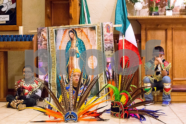 Young Matachina dancers sit during Día de la Virgen de Guadalupe feast day and mass, celebrated at St. Peter Claver Parish in Tyler, Texas, on Tuesday, Dec. 12, 2017. Día de la Virgen de Guadalupe honors the belief that Jesus' mother Mary, Mexico's patron saint, appeared to Juan Diego in Mexico City in 1531. (Chelsea Purgahn/Tyler Morning Telegraph)