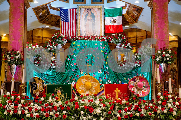 The altar at Día de la Virgen de Guadalupe feast day and mass, celebrated at St. Peter Claver Parish in Tyler, Texas, on Tuesday, Dec. 12, 2017. Día de la Virgen de Guadalupe honors the belief that Jesus' mother Mary, Mexico's patron saint, appeared to Juan Diego in Mexico City in 1531. (Chelsea Purgahn/Tyler Morning Telegraph)